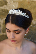 Load image into Gallery viewer, Dark haired bride wears a low silver tiara with a stone wall backdrop