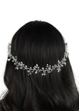 Load image into Gallery viewer, Black hair model has a single strand of wire with  crystals attached. Photo on a white background