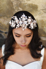 Load image into Gallery viewer, Dark Haired model wears a wide rose gold headband of flowers with the background of a stone wall