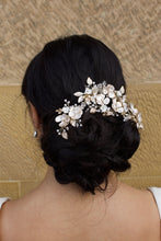 Load image into Gallery viewer, Model Bride wears a Pale Gold Bridal Vine on her dark hair with a wall as background