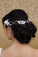 Load image into Gallery viewer, A dark haired model with curly hair wears a silver vine at the back of her head