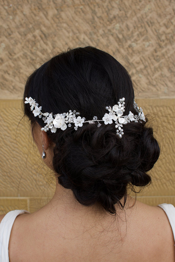 Silver Flower vine worn around the dark hair of a bridal model