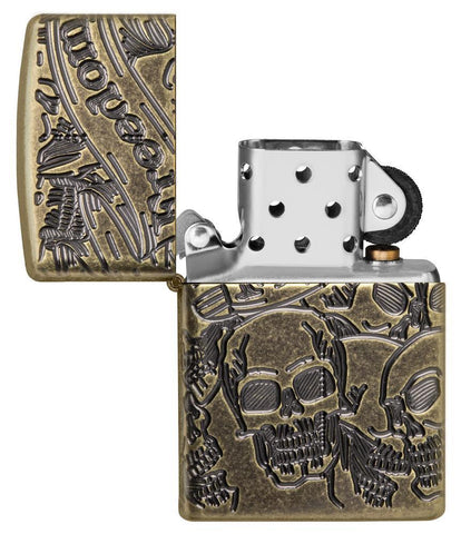 Armor® Antique Brass Skull Design Windproof Lighter with its lid open and unlit