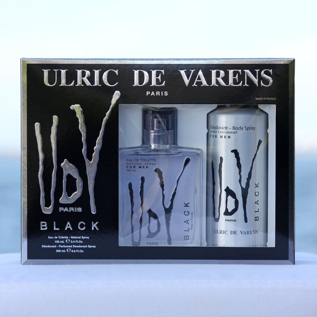 Ulric De Varens UDV Black Gift Set men's perfume 3.4 EDT and deodorant 6.8 oz in front of beach