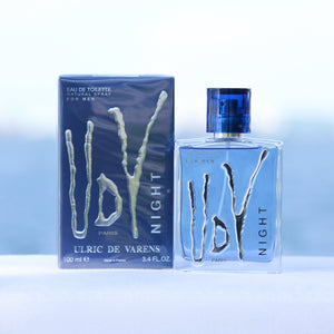 Ulric De Varens UDV Night men's perfume 3.4 EDT in front of beach