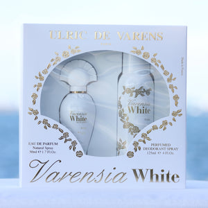Ulric De Varens Varensia White Gift Set women's perfume 1.7 EDP and deodorant 4 oz in front of beach