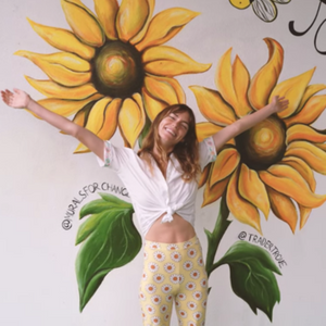 Montana Lower paints a SUNFLOWER at Trader Trove (Murals For Change)