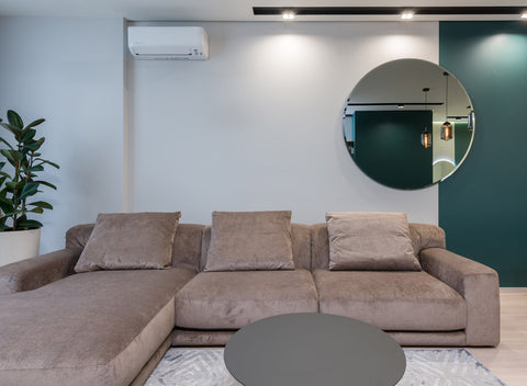 How Do You Decorate a Large Wall Over a Couch? Mirrors