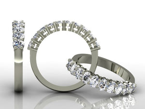 Claw Set Oval Cut Diamond Band