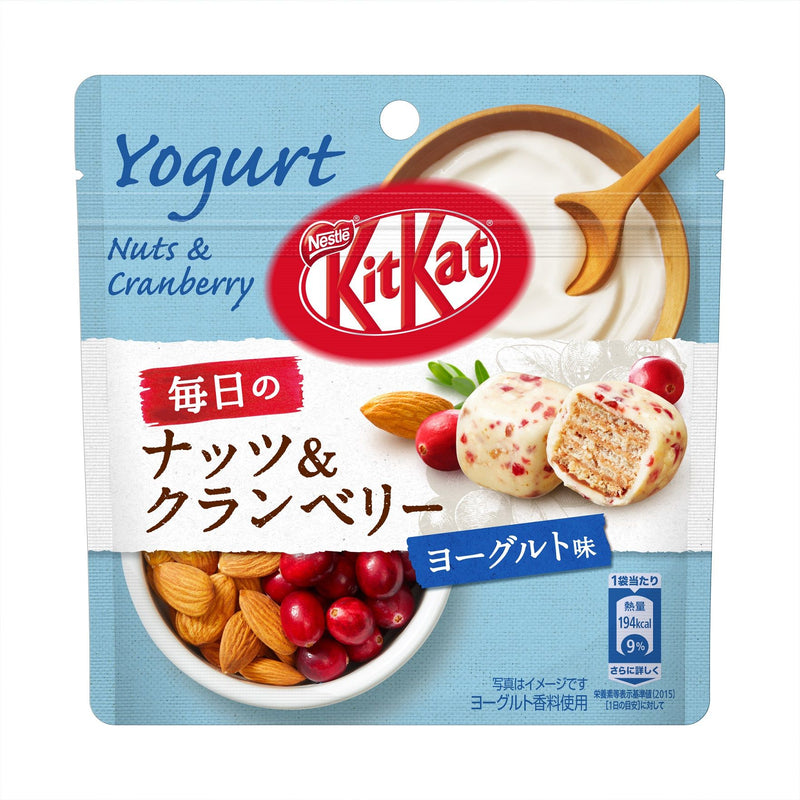Pouch of Yogurt kit kats that are nuts and cranberry flavor with a bowl of yogurt and bowl of almonds and cranberries
