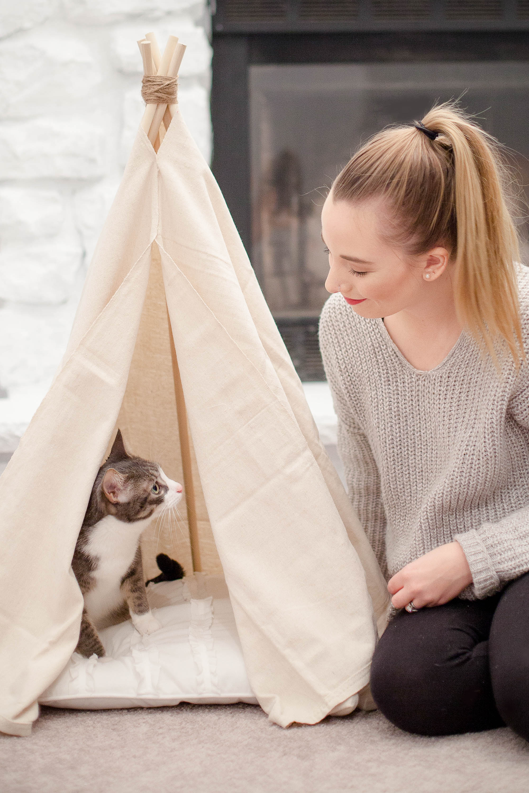 woman sitting with cat who is sitting in a no sew cat teepee bed at coffeewithsummer.com