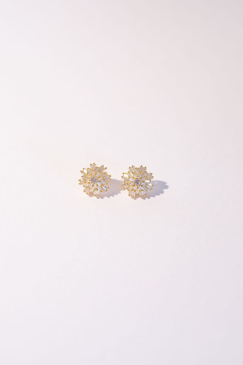 Flatlay of Shimmering crystal wedding studs for the modern bride or bridesmaid. 18K Gold detailing in a starburst formation.