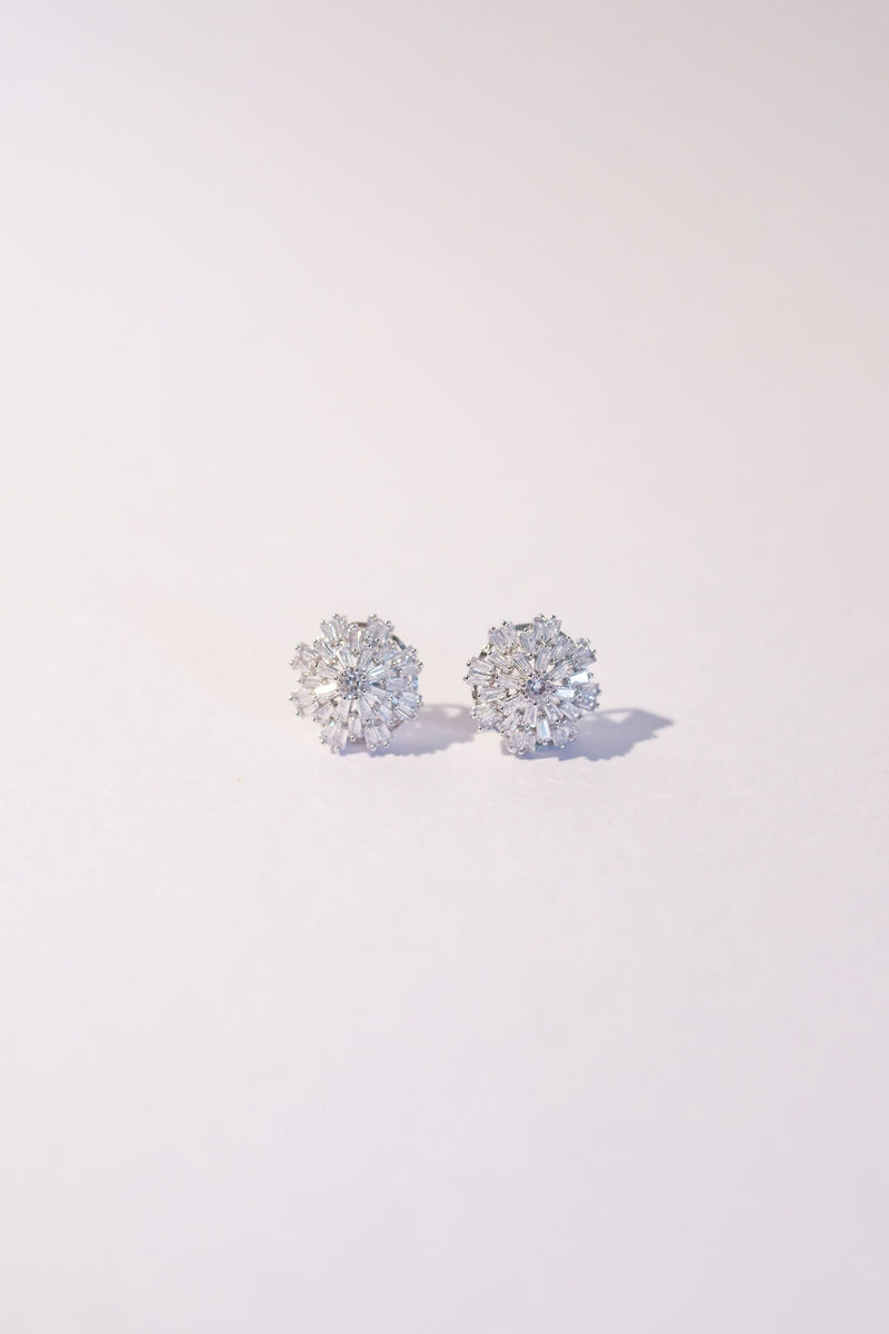 Shimmering crystal wedding studs for the modern bride or bridesmaid. White Gold / Silver detailing in a starburst formation.