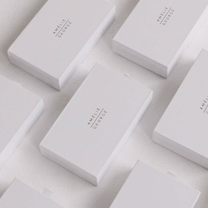 Amelie George Bridal White Gift Boxes are organized into a row.