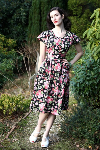 Our new Fleur dress with a black background