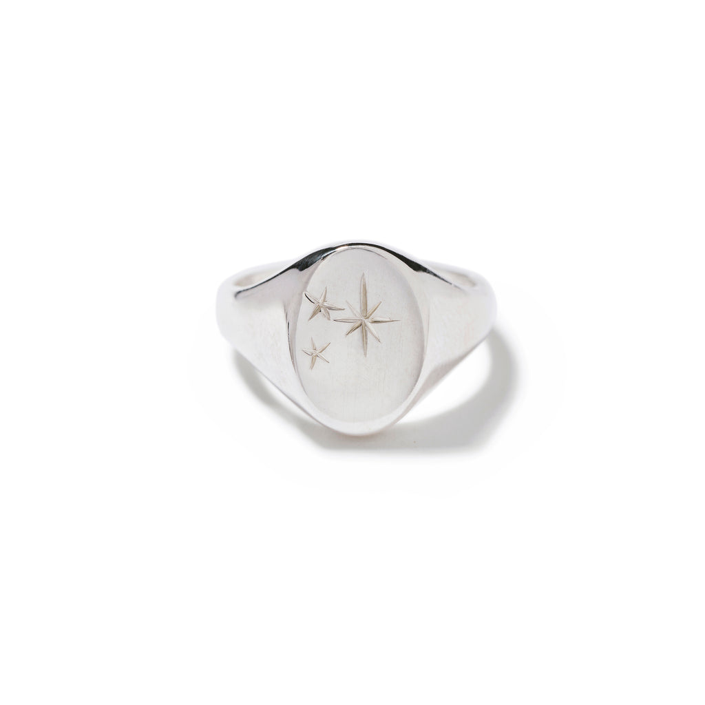 signet ring with front star cluster detail