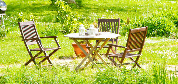 table and chairs in sunny garden