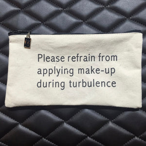 please refrain from applying makeup during turbulence.
