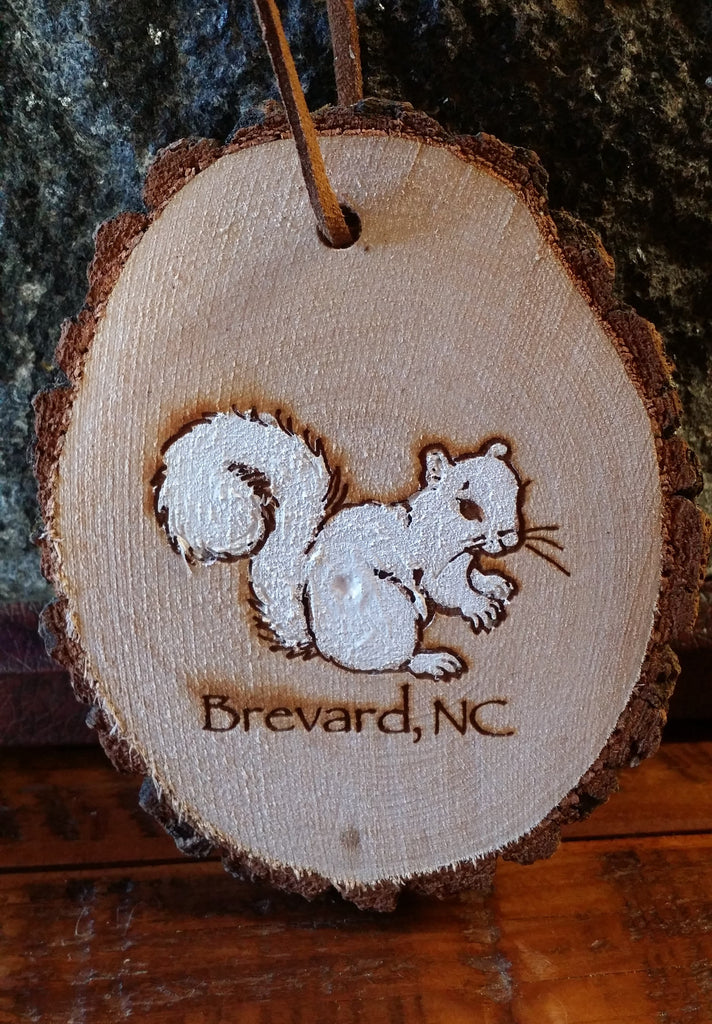 Ornament on Log Cross Section with Painted White Squirrel and Brevard, NC #