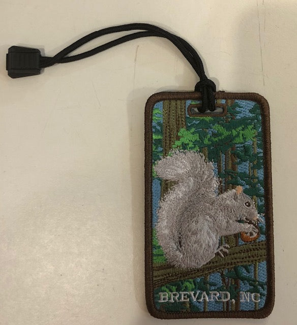"Luggage Tag - Our little White Squirrel and ""Brevard, NC"" Embroidered on Front"