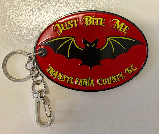 "Key Chain - Metal Key Clip with a Black Bat and Wording ""Just Bite Me"""