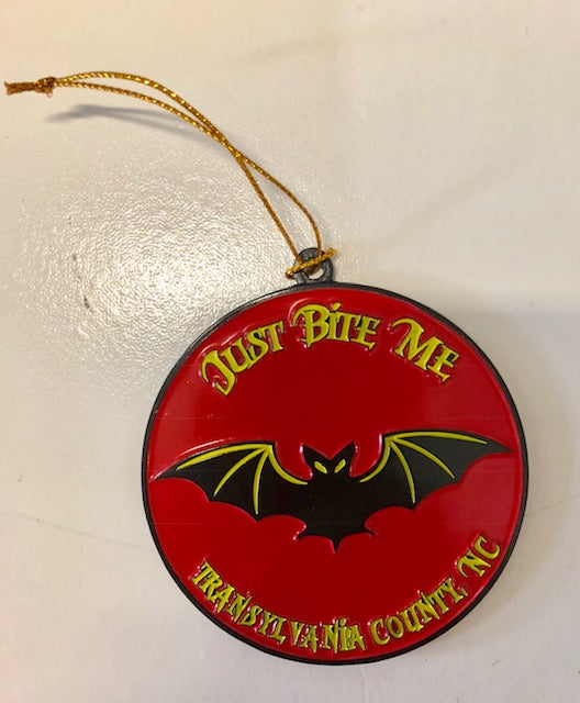 "Ornament - Round Black Metal Bat with the wording ""Just Bite Me, Transylvania County"""