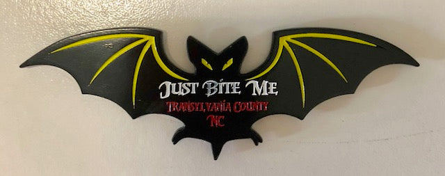 "Magnet - Black Metal Bat with the wording ""Just Bite Me, Transylvania County, NC"""