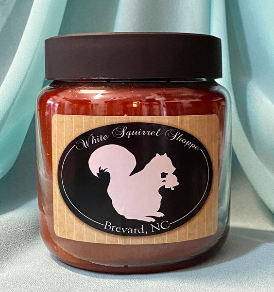 Candle - Buttered Maple Syrup and Mama's Sweet Tea Scent in a Jar labeled White Squirrel Shoppe Brevard, NC #
