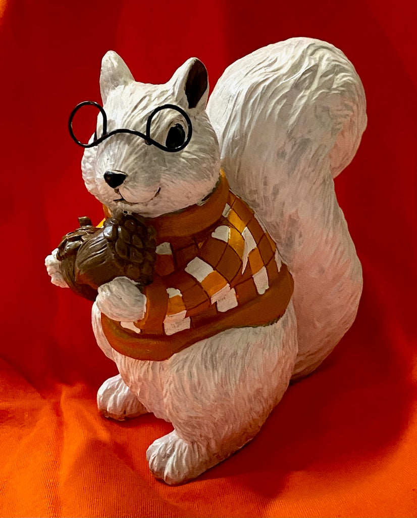 Figurine - White Squirrel With a Checkered Shirt Holding Acorns