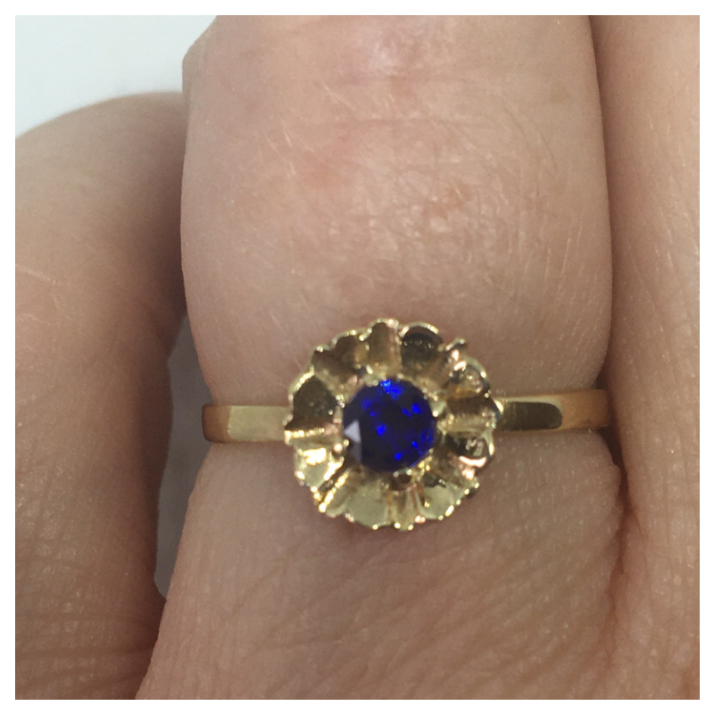Gold Flower Style ring with Blue Stone Centre