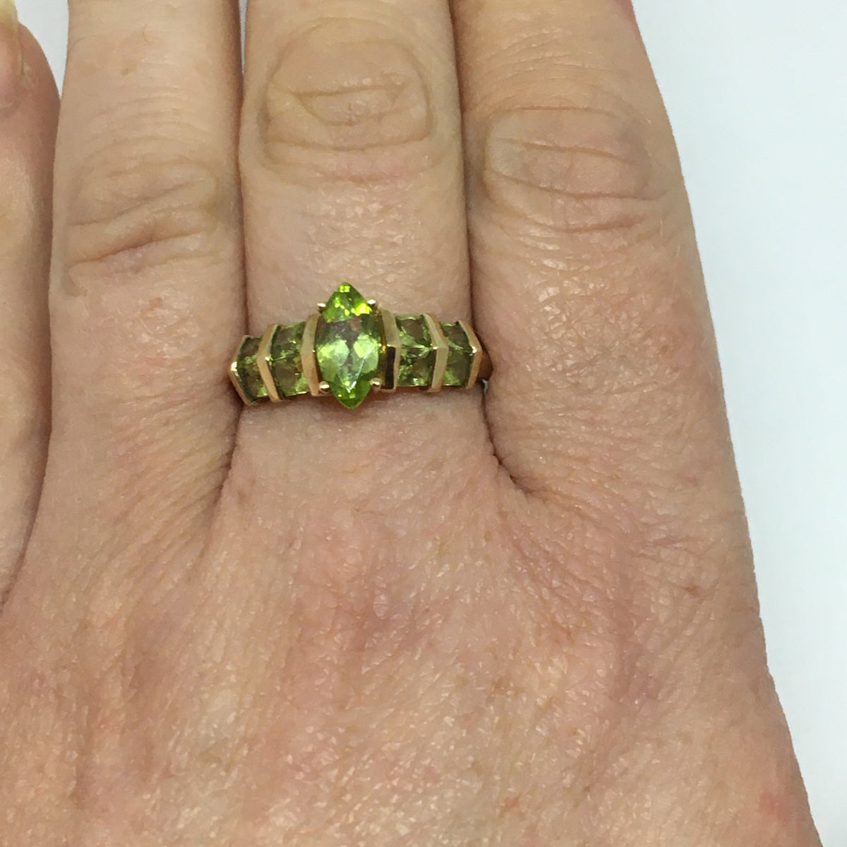 Gold Ring with five Peridot colour Stones