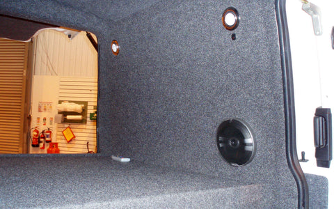 Rear of T4 camper bed with speakers and lights