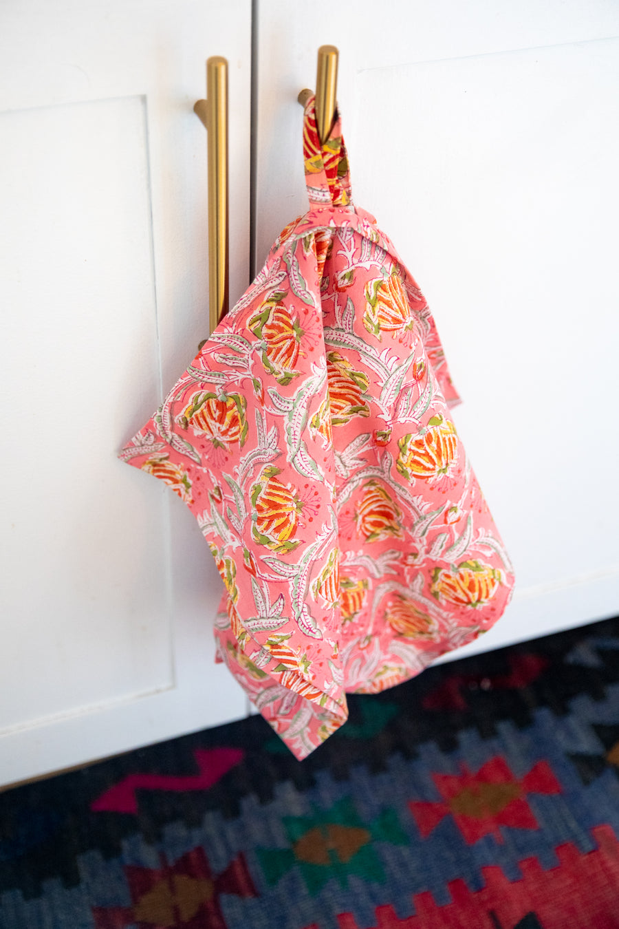 Furbish Studio - Blockprint Kitchen Towels - Coral, yellow, and green floral printed hand towel hanging in a kitchen