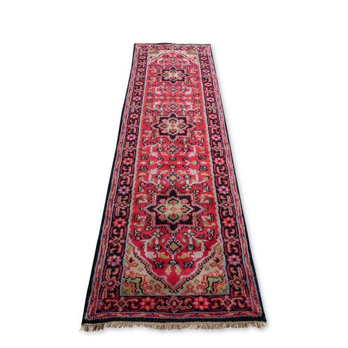 Vintage turkish rug in red , cream and black with cream fringe.