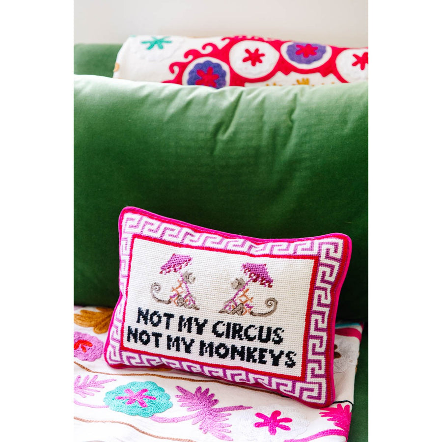 Furbish Studio - Not My Circus Needlepoint Pillow styled on green couch with colorful blankets