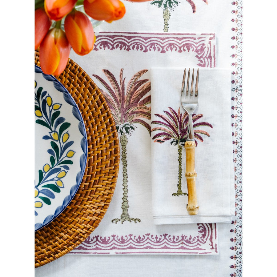 Furbish Studio - Pink Palm Napkin and Placemat on table with bamboo fork and plate