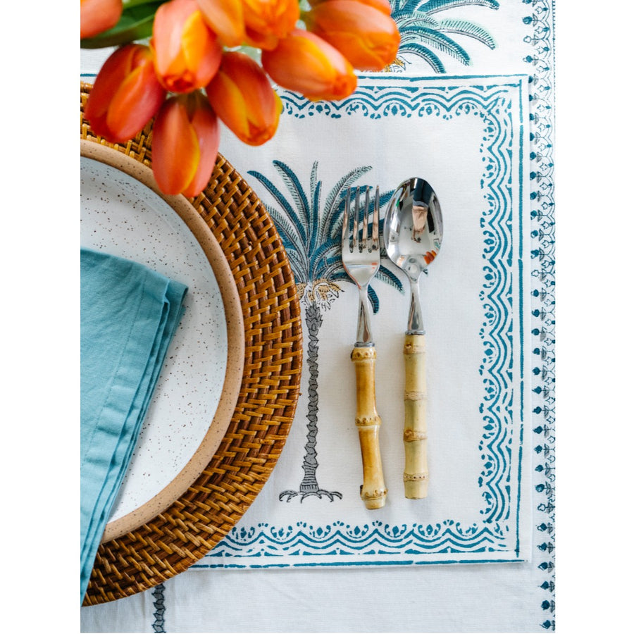 Furbish Studio - blue palm tablecloth and placemat on table with bamboo cutlery