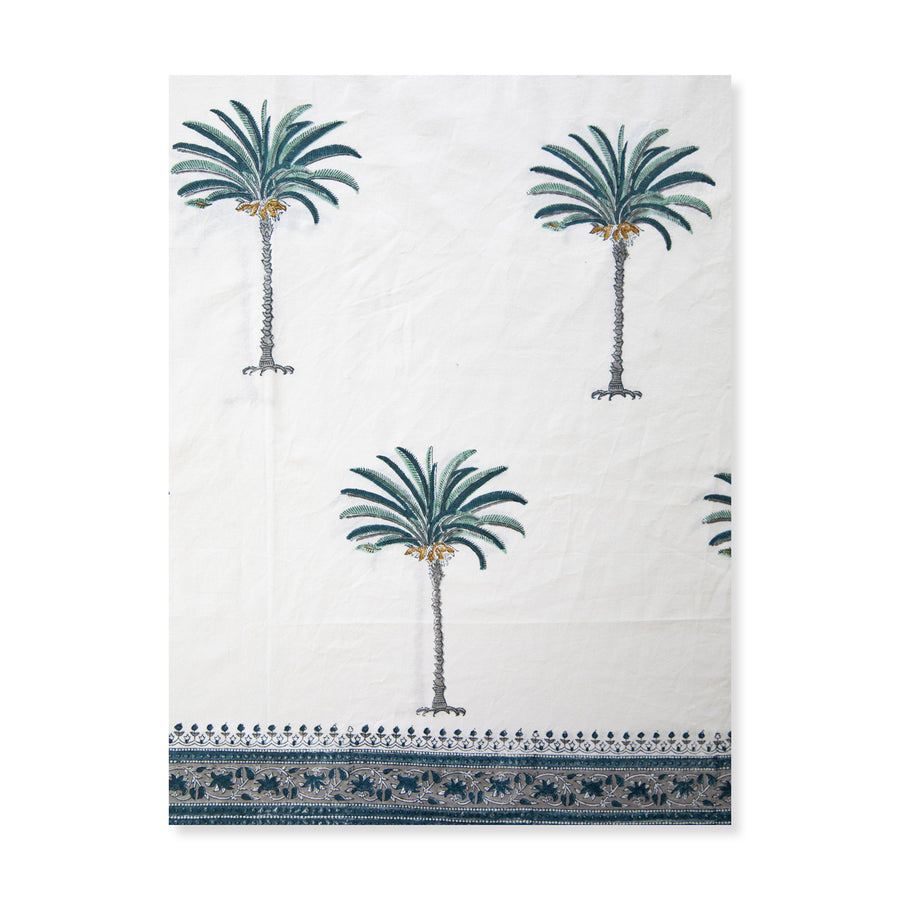 Furbish Studio - blue palm tablecloth closeup of border edge