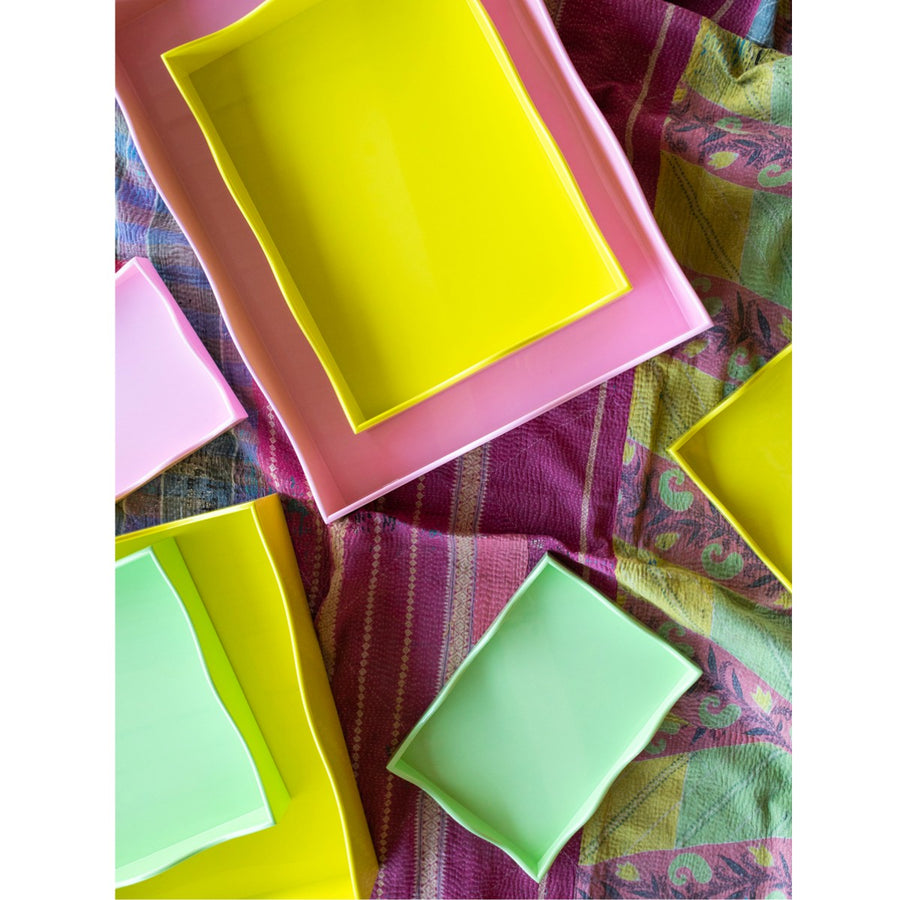 Furbish Studio Belles Rives trays scattered on colorful textile