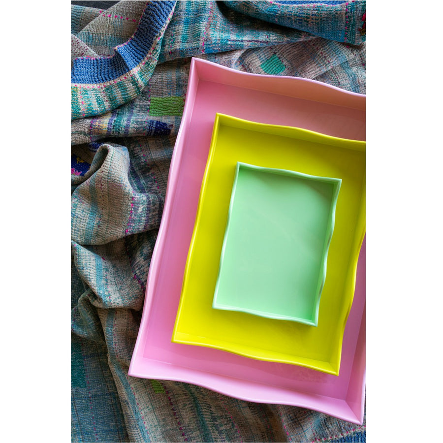 Furbish Studio Belles Rives trays stacked overhead shot of pink, yellow and mint