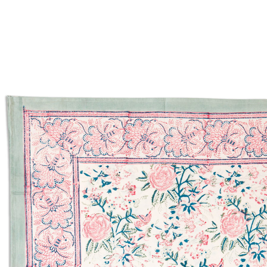 Furbish Studio - Shefali Tablecloth in pinks, greens, blues and cream floral showing closeup of corner edge