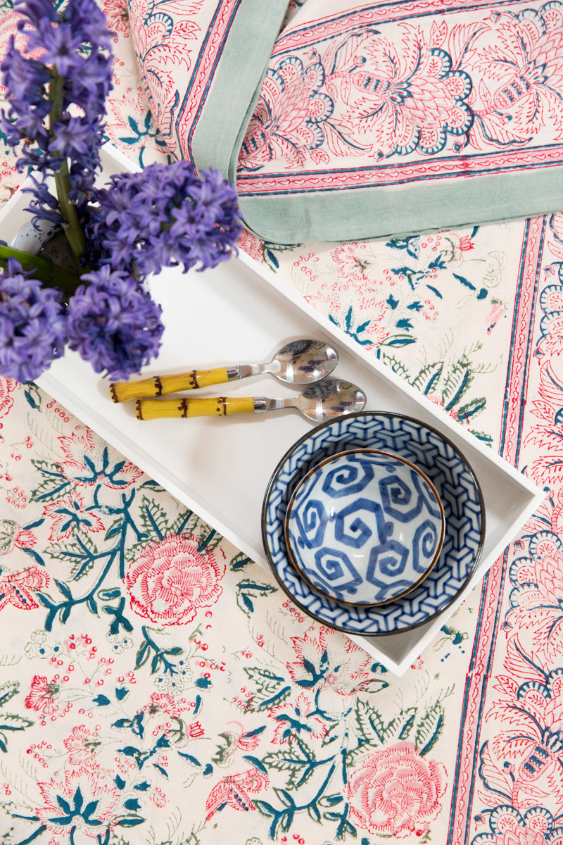 Furbish Studio - Shefali Tablecloth in pinks, greens, blues and cream floral shown styled on table