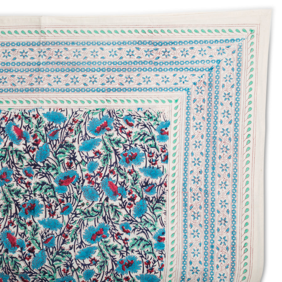 Furbish Studio - Noelle Tablecloth in blue and red florals closeup of corner edge