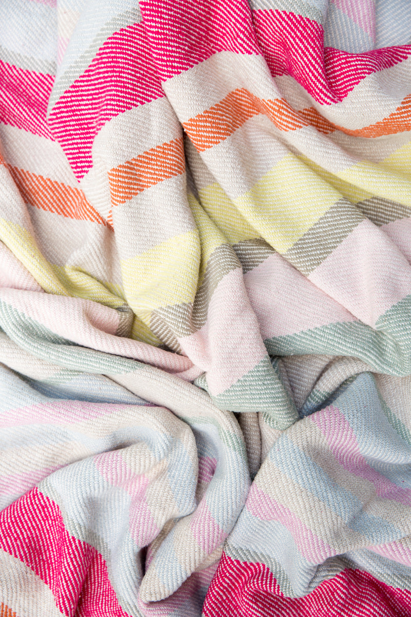 Furbish Studio - Abbot Kinney Woven Cotton Blanket with Muted Stripes shown bunched