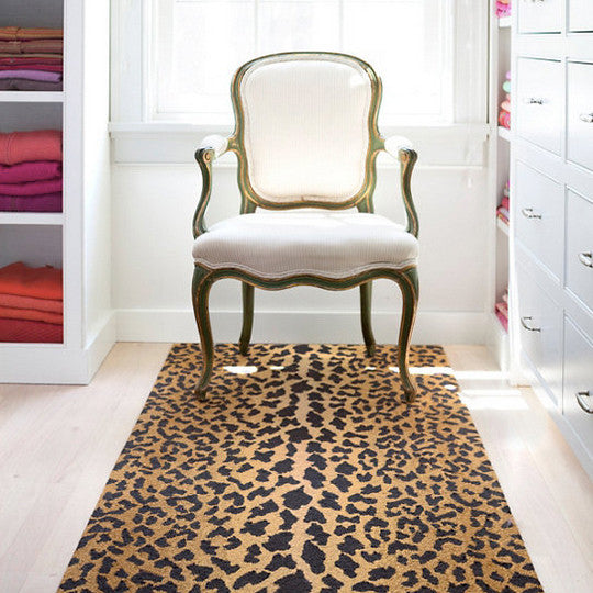 Furbish Studio - Leopard Print Wool Rug styled with white french chair in fancy closet