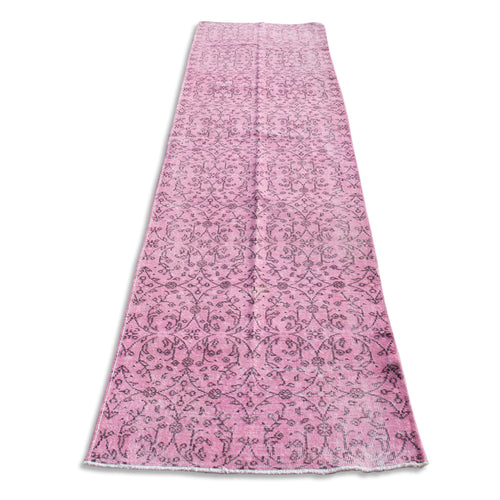 Alva faded pale pink oushak vintage long wool runner rug with darker accents in a bohemian style