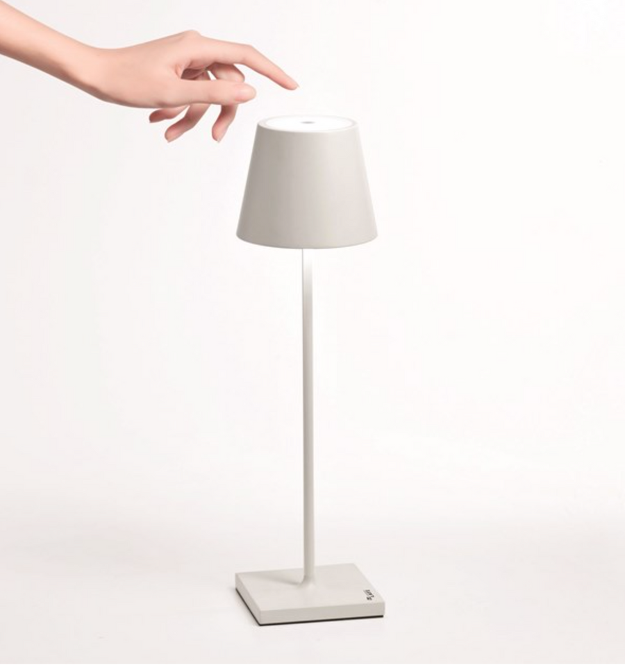 Furbish Studio - Annabelle Rechargeable Table Lamp in white shown touching top on/off control