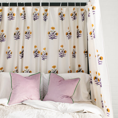 Furbish Studio - Marigold Tie Top Curtains with yellow, purple and green floral pattern shown in bedroom
