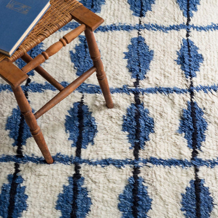 Furbish - ChiChi Ivory and Indigo Plushy Wool Rug styled with a woven chair and book