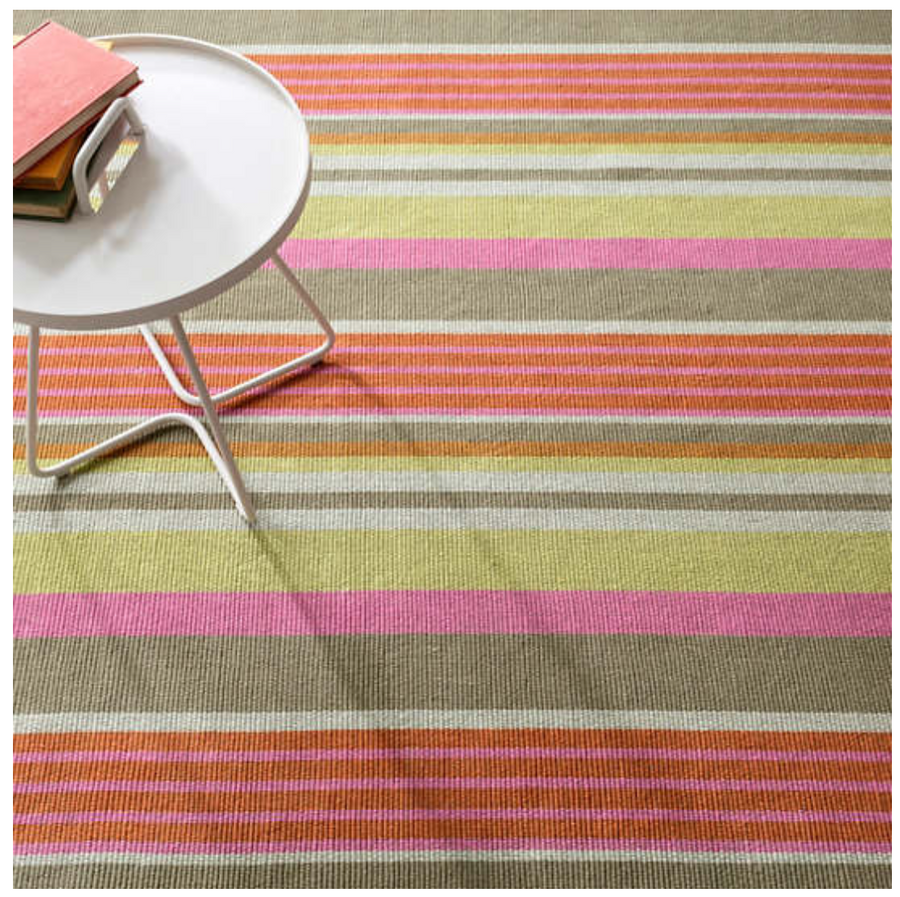 Furbish Studio - Joshua Tree Striped Rug in pink, orange, taupe styled with an outdoor side table and books